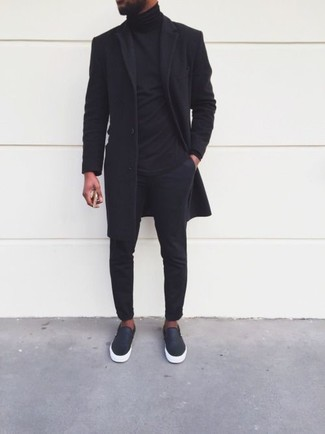 How to wear: black leather slip-on sneakers, black chinos, black turtleneck, black overcoat