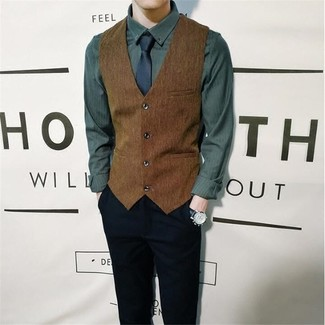 How to wear: navy tie, black chinos, dark green long sleeve shirt, brown waistcoat