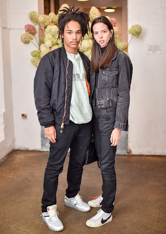 How to wear: grey leather high top sneakers, black chinos, grey print crew-neck t-shirt, black bomber jacket