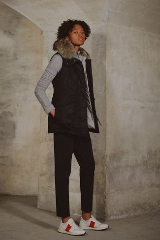 How to wear: white athletic shoes, black chinos, grey sweatshirt, black gilet