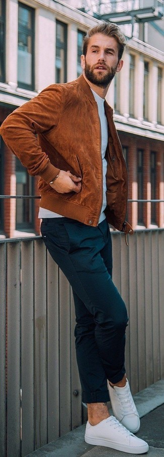 How to wear: white canvas low top sneakers, black chinos, light blue sweatshirt, tobacco suede bomber jacket
