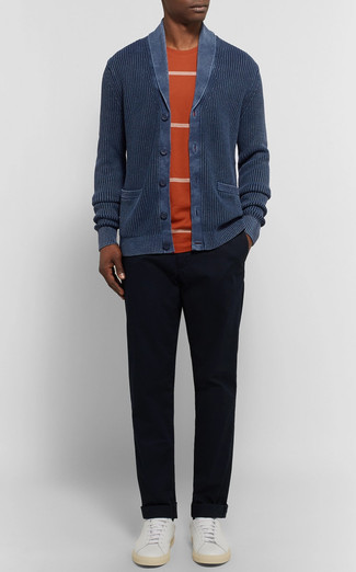 How to wear: white leather low top sneakers, black chinos, orange horizontal striped crew-neck t-shirt, navy shawl cardigan