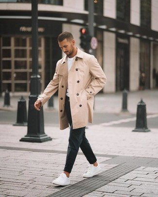 How to wear: white low top sneakers, black chinos, white crew-neck t-shirt, tan trenchcoat