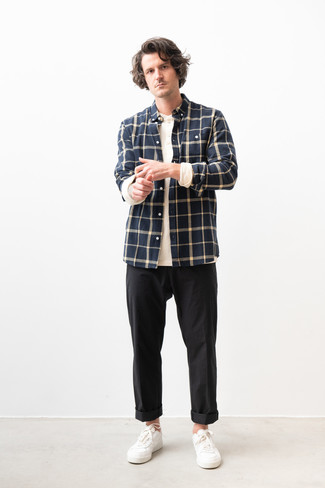 Men's Looks & Outfits: What To Wear In 2020: Channel your inner easy-going self and wear a navy check flannel long sleeve shirt and black chinos. Add a pair of white leather low top sneakers to the equation et voila, the getup is complete.