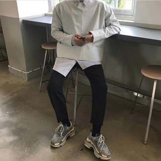 How to wear: grey athletic shoes, black chinos, white long sleeve shirt, grey sweatshirt