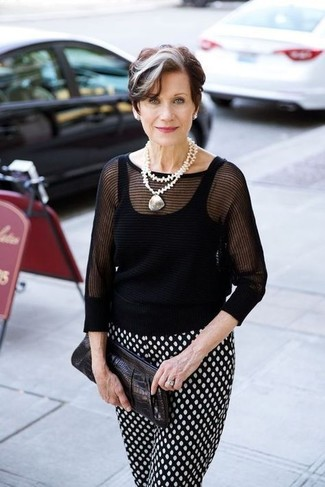 Women's Looks & Outfits: What To Wear In 2020: When comfort is key, this pairing of a black short sleeve sweater and black and white polka dot tapered pants is a no-brainer.