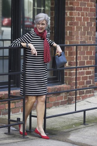 How to Wear a Black Leather Clutch: We give a huge thumbs up to this casual combo of a black and white horizontal striped shift dress and a black leather clutch! Red suede ballerina shoes round off this getup quite well.