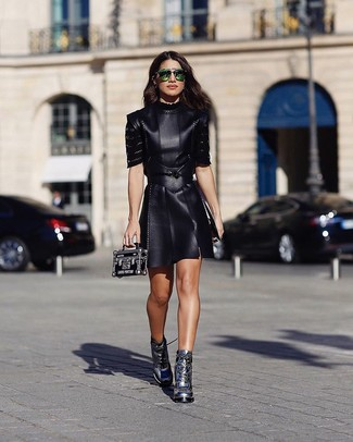 How to Wear Silver Boots For Women: If you appreciate functional outfits, choose a black leather skater dress. Dial up the fashion factor of your look by finishing off with silver boots.