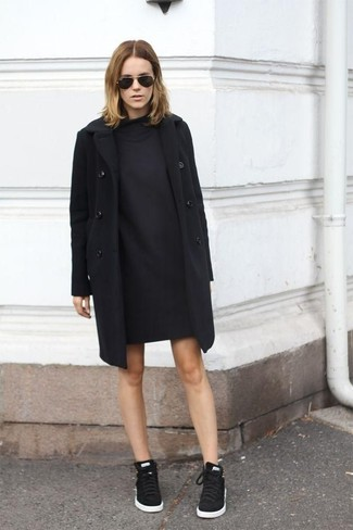 Women's Black Coat, Black Sweater Dress, Black Low Top Sneakers, Black Sunglasses