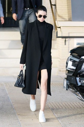 Kendall Jenner wearing Black Coat, Black Sweater Dress, White Leather Low Top Sneakers, Black Leather Tote Bag
