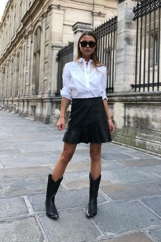 How to wear: black sunglasses, black leather cowboy boots, black leather mini skirt, white dress shirt