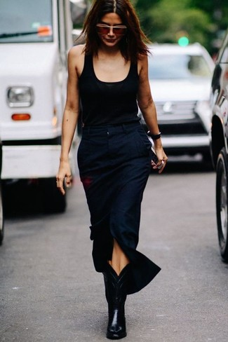 How to wear: brown sunglasses, black leather cowboy boots, navy slit midi skirt, black tank