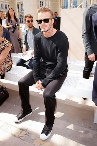 David Beckham wearing Black Crew-neck Sweater, Black Chinos, Black and White Low Top Sneakers