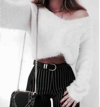 How to wear: black leather belt, black embellished leather crossbody bag, black and white vertical striped skinny pants, white mohair crew-neck sweater