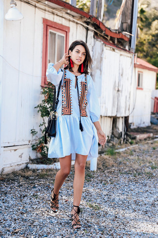 How to wear: red earrings, black leather crossbody bag, black suede heeled sandals, light blue embroidered peasant dress