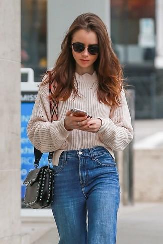 How to wear: black sunglasses, black embellished leather crossbody bag, blue jeans, beige knit oversized sweater