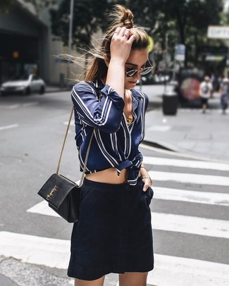 How to wear: black and gold sunglasses, black leather crossbody bag, navy suede mini skirt, navy and white vertical striped silk dress shirt