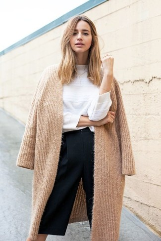 How to wear: black culottes, white crew-neck sweater, camel knit coat
