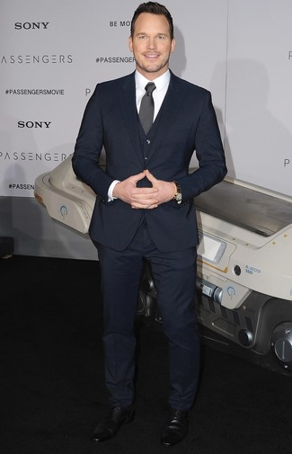 How to wear: black and white polka dot tie, black leather derby shoes, white dress shirt, navy three piece suit