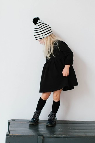 How to wear: black dress, black boots, white horizontal striped beanie, black socks