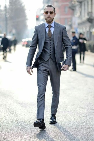 How to wear: olive tie, black leather dress boots, light blue dress shirt, grey three piece suit
