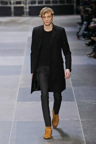 How to wear: tan suede cowboy boots, black dress pants, black crew-neck t-shirt, black overcoat