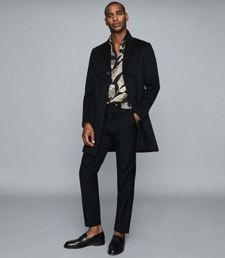 How to wear: black leather loafers, black dress pants, black print long sleeve shirt, black overcoat