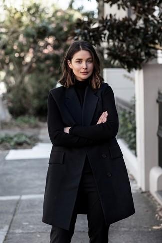 How to wear: black dress pants, black turtleneck, black sleeveless coat