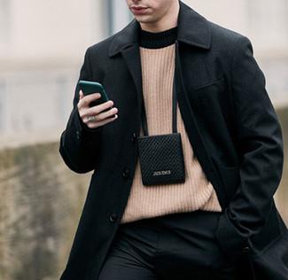 How to wear: black neck pouch, black dress pants, tan crew-neck sweater, black overcoat
