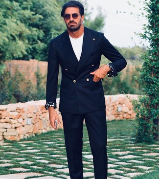 How to wear: dark brown sunglasses, black dress pants, white crew-neck t-shirt, black double breasted blazer