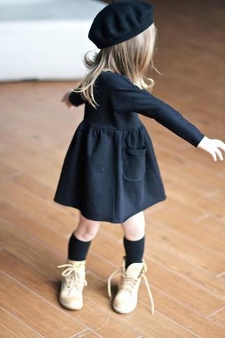 How to wear: black dress, tan boots, black beret, black socks