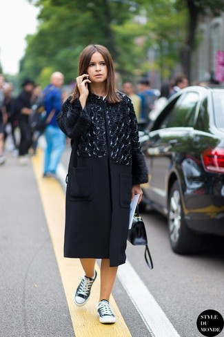 Miroslava Duma wearing Black Embellished Coat, Black and White Low Top Sneakers, Black Leather Satchel Bag
