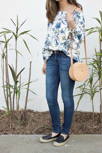 How To Wear Skinny Jeans With Espadrilles: Breathe style into your current wardrobe with a white floral off shoulder top and skinny jeans. Complete this look with espadrilles and ta-da: the outfit is complete.
