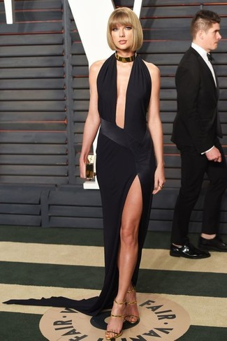 Taylor Swift wearing Black Slit Evening Dress, Gold Leather Heeled Sandals, Gold Clutch, Gold Necklace