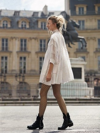 How to wear: black fishnet tights, black studded leather lace-up flat boots, white lace swing dress