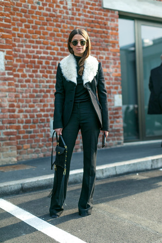 How to wear: black leather crossbody bag, black flare pants, black turtleneck, black and white fur collar coat
