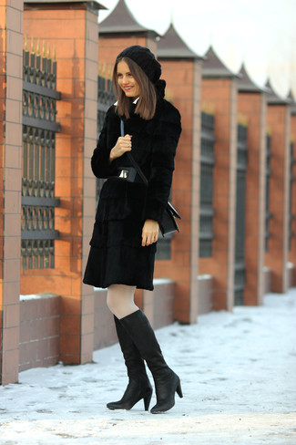 Make people go weak in their knees by wearing a black fur coat. For a more relaxed take, rock a pair of black leather knee high boots. When it's one of those gloomy autumn days, sometimes only a cool outfit like this one can spice it up.