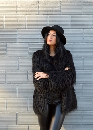 How to wear: black fur coat, black leather skinny pants, black wool hat