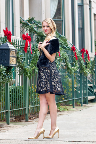 How to wear: black fur scarf, gold leather pumps, black lace fit and flare dress