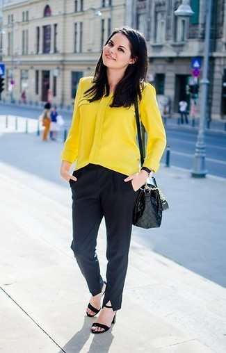 How to wear: black quilted leather crossbody bag, black suede heeled sandals, black dress pants, yellow button down blouse