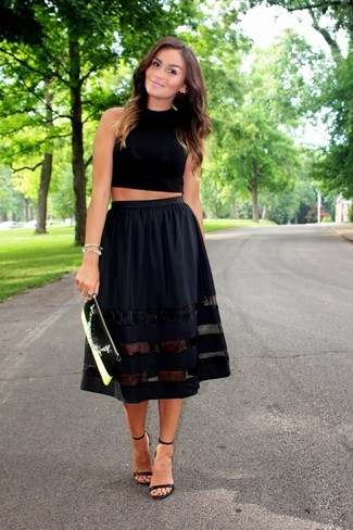How to wear: black and white leather clutch, black leather heeled sandals, black full skirt, black cropped top