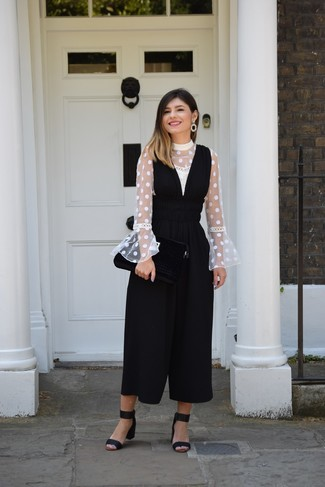 How to wear: black earrings, black suede heeled sandals, black jumpsuit, white polka dot long sleeve blouse