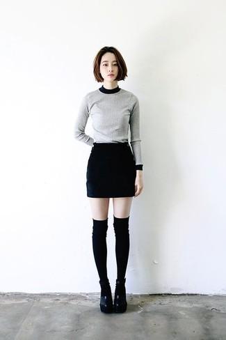 How to wear: black knee high socks, black chunky leather heeled sandals, black mini skirt, grey crew-neck sweater