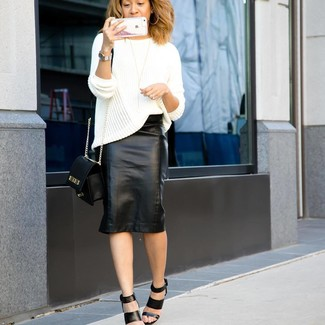 How to wear: black leather crossbody bag, black leather heeled sandals, black leather pencil skirt, white knit oversized sweater