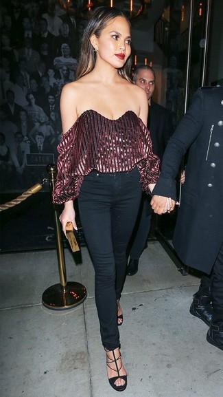 How to wear: black and gold clutch, black suede heeled sandals, black skinny jeans, burgundy velvet off shoulder top