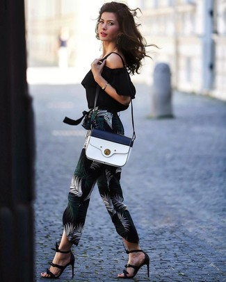 How to wear: white and navy leather crossbody bag, black leather heeled sandals, black print tapered pants, black off shoulder top