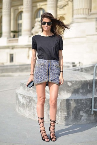 How to wear: black sunglasses, black leather heeled sandals, blue tweed mini skirt, black crew-neck t-shirt