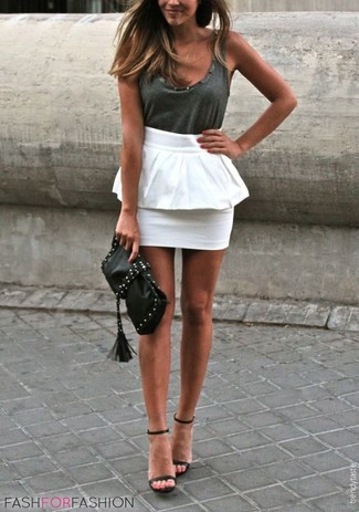 How to wear: black studded leather clutch, black leather heeled sandals, white peplum skirt, charcoal tank