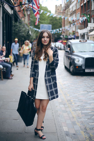 How to wear: black leather tote bag, black leather heeled sandals, white shift dress, navy check coat
