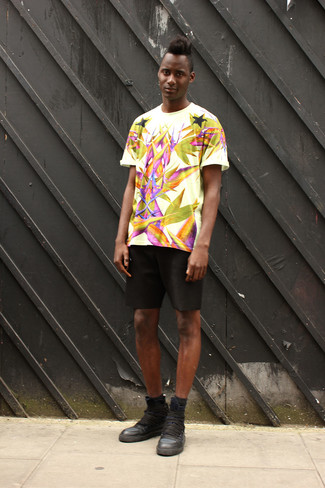 How to Wear Black Shorts For Men: A white print crew-neck t-shirt and black shorts are a good combo to add to your off-duty styling lineup. Black leather high top sneakers look wonderful here.